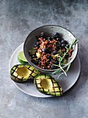 Vegetarian courgette rice with blueberries and grilled avocado