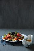 Millet and lentil salad with oven-roasted vegetables and blackberries