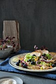 Pasta with pinted cabbage, chicken breast fillet and blueberries