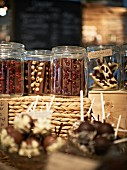 Various chocolate stars in storage jars