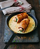 Stuffed veal roulade with a white wine sauce