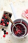 Fresh berries being sieved