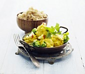 Fish curry with coriander and rice