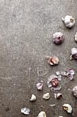 Whole garlic bulbs and individual garlic cloves (seen above)