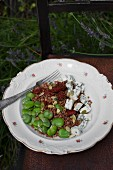 Buckwheat with broad beans, dried tomatoes, blue cheese and pumpkin seeds