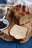 Challah with a cup of cocoa and redcurrant jam