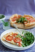 Puff pastry tarts with red pesto, blue cheese, mozzarella, tomatoes and rocket