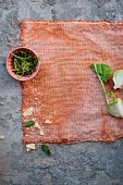 Kohlrabi, Parmesan and herbs on a cloth