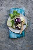 Green and purple kohlrabi on a plate