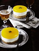 Orange cream cakes with biscuit bases