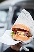 A hamburger in paper