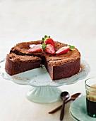 Flourless chocolate cake, sliced on a cake stand