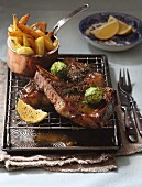 Beef steak with Parmesan chips and herb butter