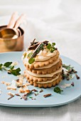 A stack of biscuits with mascarpone cream and peppermint