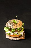 A vegetarian burger with a seitan patty and chia seeds