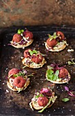 Beetroot falafel on mini pita breads with herbs