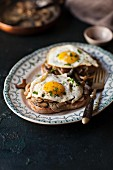 Fried mushrooms and a fried egg on toast