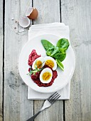 Beetroot purée with hard-boiled eggs and spinach
