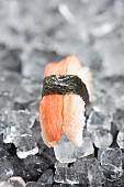Nigiri sushi with crab on ice