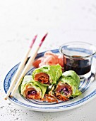 Lettuce rolls filled with smoked salmon with a wasabi dressing (Asia)