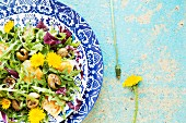 Mixed leaf salad with polenta, olives and dandelion flowers