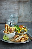 Spicy chicken with a corn salad