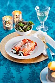 Lasagne rolls with ricotta, spinach and tomato sauce for Christmas
