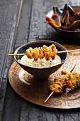 Spicy oriental mussel soup with mussel skewers