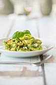 Tortellini with pesto, leek and pine nuts
