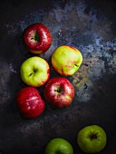 Various organic apples on a metal surface
