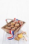 Fresh potatoes from Holland in a wooden basket