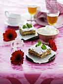 Cream slices with icing sugar and whipped cream