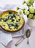 Spinach quiche with smoked trout