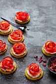 Plum tartlets with rose and cardamom syrup