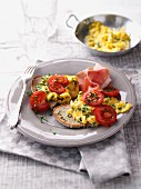 Herb scrambled egg with ham and fresh tomatoes