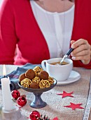 Coffee with brittle truffle pralines for Christmas