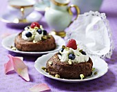 Chocolate cake filled with vanilla ice cream, berries and pistachio nuts