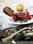 Beef tatar with beetroot, egg and wholemeal bread