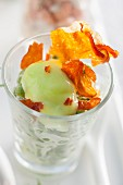 Wasabi peas with ham crisps in a glass