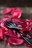 Rose petals with wooden cutlery