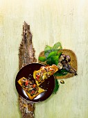Chestnuts and black chanterelles with tomatoes on grilled bread