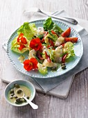 Fish salad with nasturtium flowers and a caper dressing