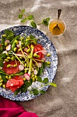 A mixed leaf salad with grapefruit and edamame beans served with a sweet-and-spicy ginger and maple syrup sauce