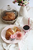 Fresh croissants, jam and coffee