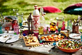 A Moroccan summer party with various dishes on a garden table