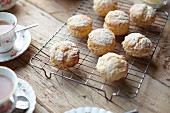 Scones on a wire rack served with afternoon tea
