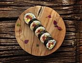 Futomaki sushi with tuna fish, cucumber and avocado