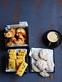 Italian biscuits and pastry served with espresso, apricots cornetti, brutti e buoni and orange and polenta biscuits with saffron