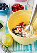 Berry yoghurt ice cream being made