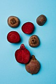 Beetroot on a blue surface, partially halved